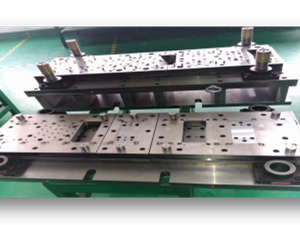 Precision continuous stamping die